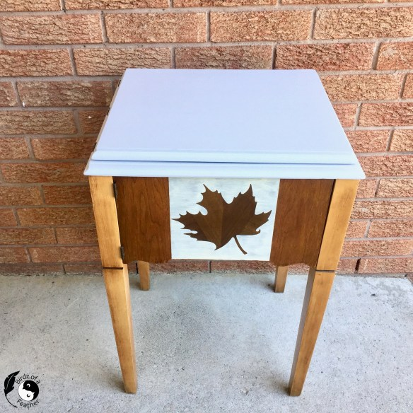 A vintage sewing table decorated with a Fall maple leaf; Craft Ideas for Autumn