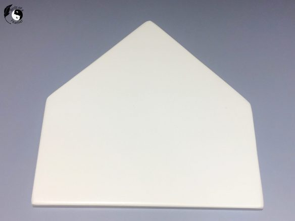 House-shaped MDF board used as a backer for string art, painted white