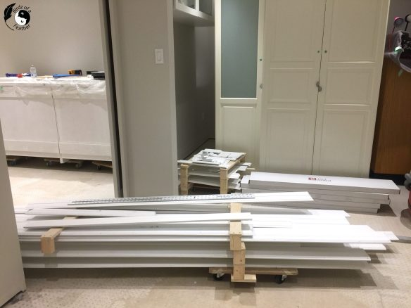 Baseboard that was removed during flood can sit on dollies so it can be move around as the loose lay floor is installed
