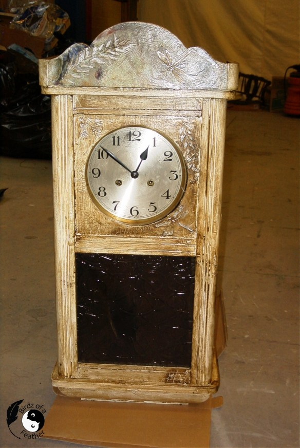 Clock showing finished decoupage on wood project.