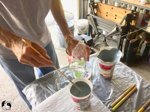 Watering down the paint to prepare for How to Paint Using a Spray Gun