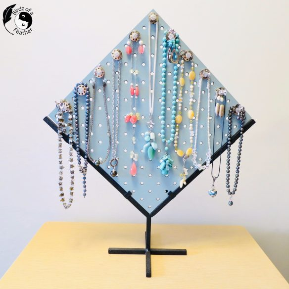 pegboard jewelry stand is the finished project on How to Paint Using a Spray Gun