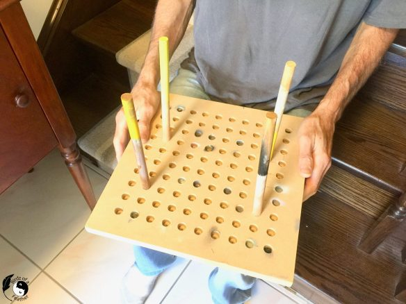 Paint jig with dowels for painting with a spray gun