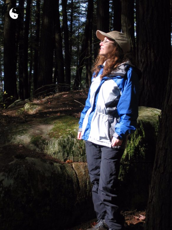 Woman in a forest enjoying the fresh air and scenery