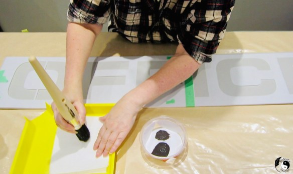 Offload paint onto paper towels for how to stencil on wood