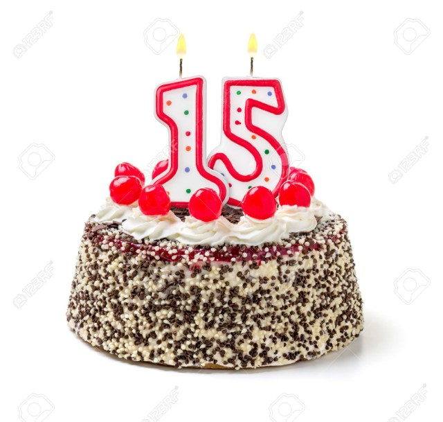 15 Birthday Cake Birthday Cake With Burning Candle Number 15 Stock Photo Picture And