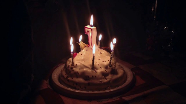 7 Year Old Birthday Cake Birthday Cake 7 Years Old Blowing Candles In The Dark Stock Video