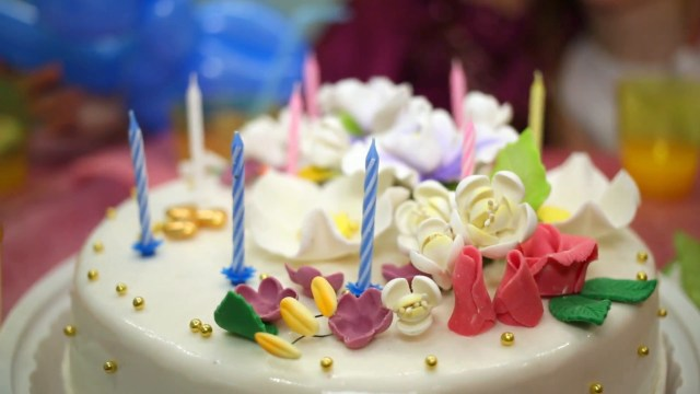 Birthday Cake Flowers Child Hand Counts Candles On Decorated With Cream