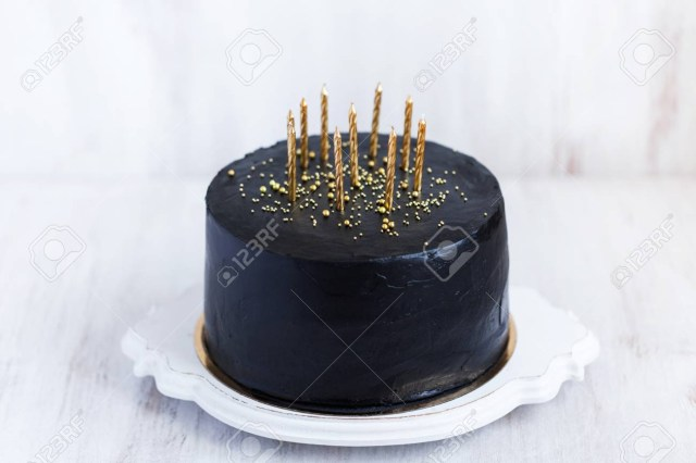 Black Birthday Cake Black Birthday Cake With Golden Candles On White Background Stock