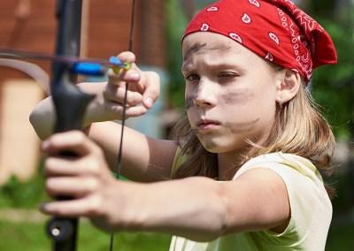young=girl-shooting-bow-and-arrow