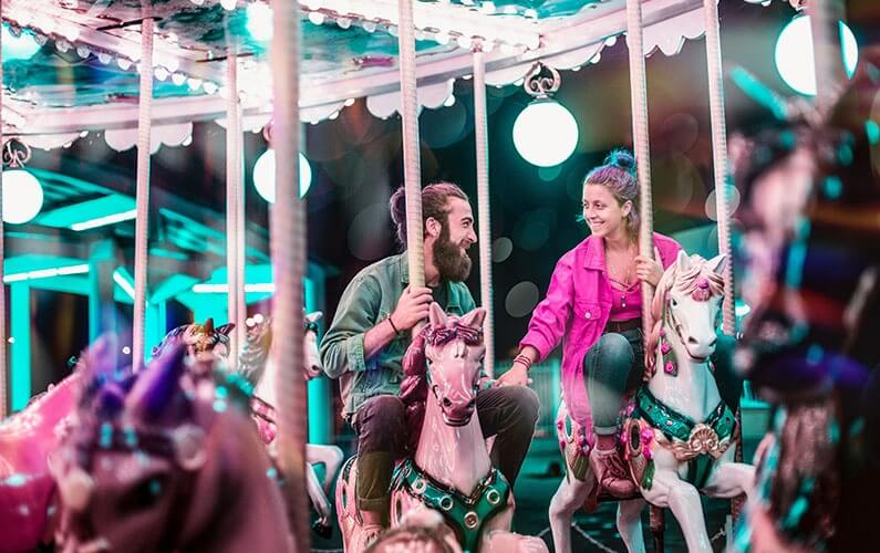 young-couple-riding-carousel