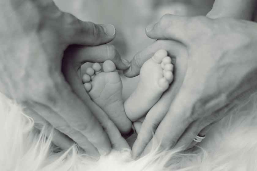 Baby's Massage feet in parents hands