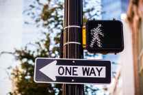 shallow focus photo of road sign on pole