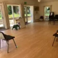 A room set up for teaching. A light, spacious, airy room.