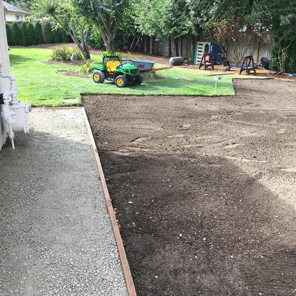 IN PROGRESS: Gravel border and sod
