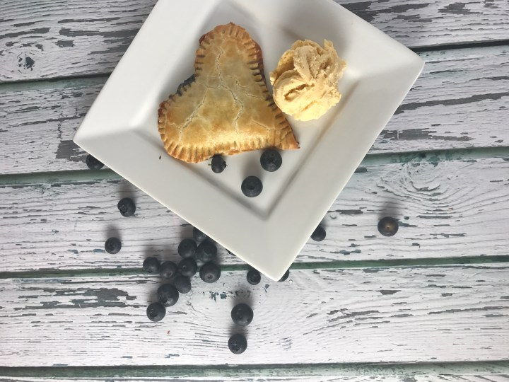 These heart shaped blueberry hand pies are easy to make, and feature our easy homemade flaky buttery pie crust.