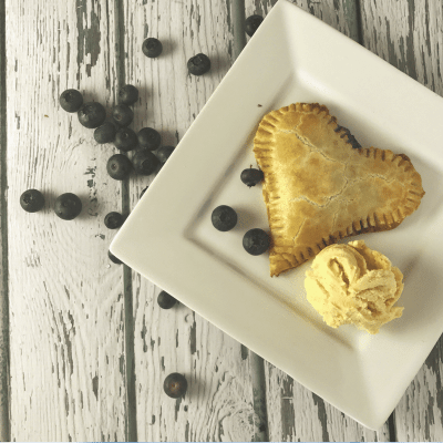 These heart shaped blueberry hand pies are easy, delicious, low in added sugar, and a great treat for your sweetheart!