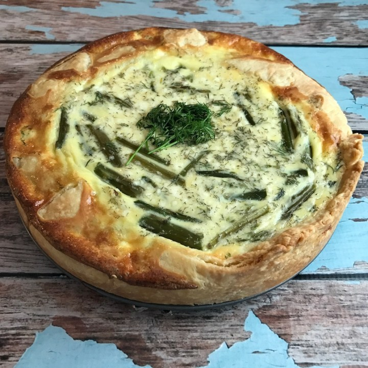 This easy to make asparagus, goat cheese, and dill quiche is perfect for spring, easily adaptable, and great for Easter Brunch! www.biscuitsandbooze.com