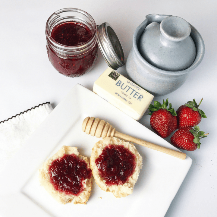 An easy to follow, low sugar, no pectin strawberry lime jam recipe that is fabulous on toast or as a topping for brie or other savory dishes! Two easy versions! www.biscuitsandbooze.com