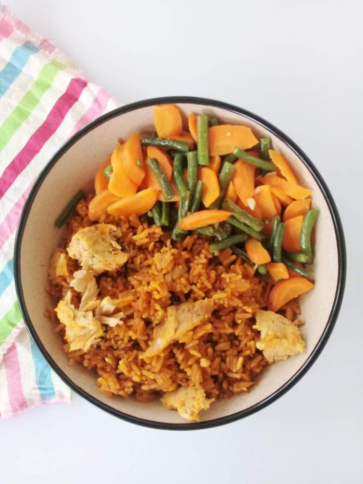 Jollof with carrots and green beans: Classic West African rice dish cooked by steaming rice in tomato gravy and finished with the addition of tuna. Carrots and green beans make an excellent side.