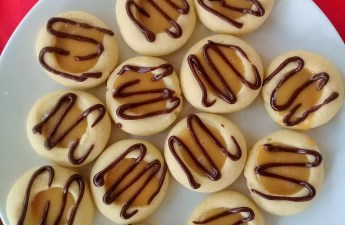 Dreamy, decadent and melt in your mouth caramel thumb print cookies.