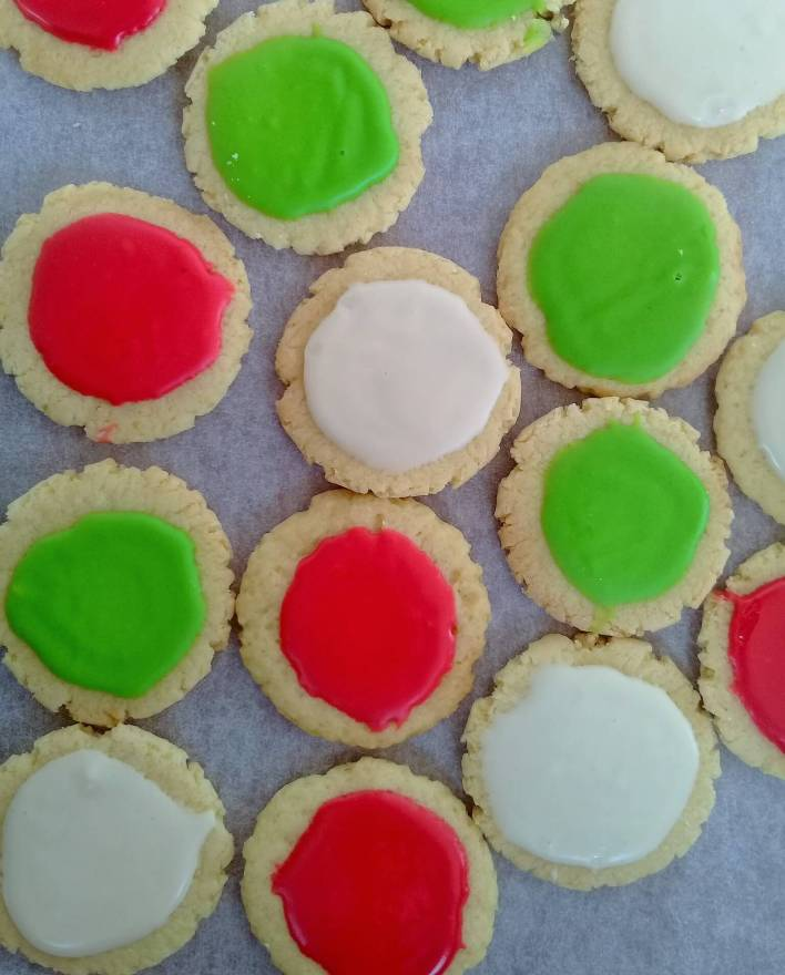 Iced almond biscuits: almond flavoured biscuits topped with almond icing.
