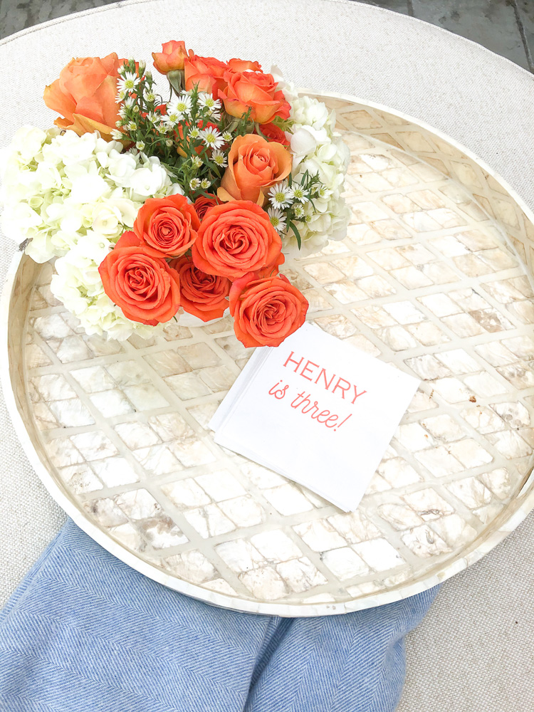 personalized napkins on a tray with orange and white flowers