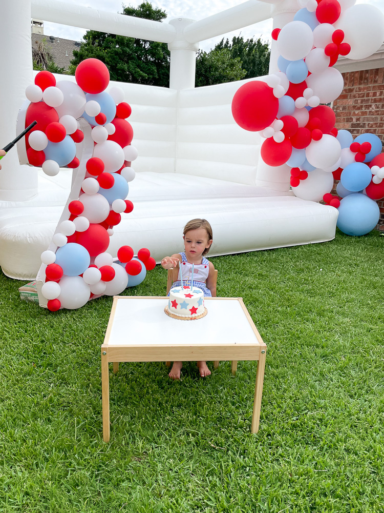 two year old boy sitting with birthday cake