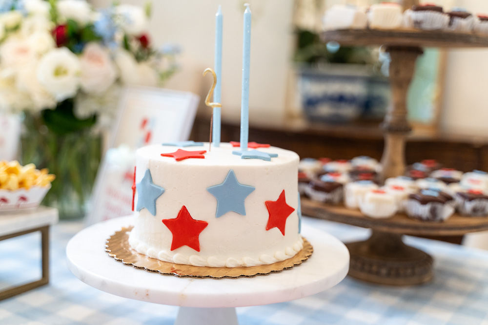 star birthday cake with number two candle