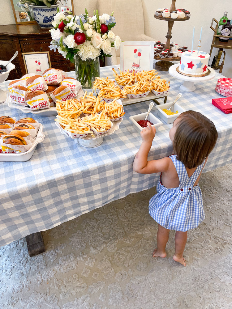 toddler looking at dining table with food