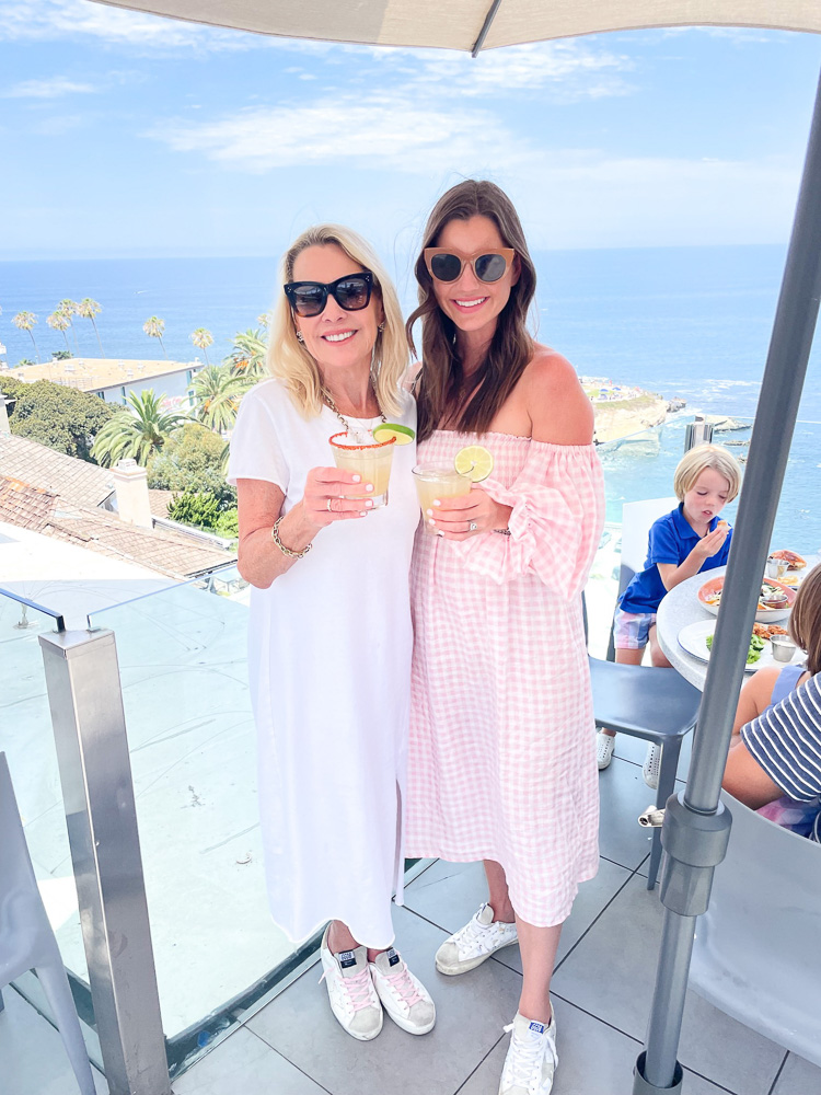 two women with cocktails and sea view