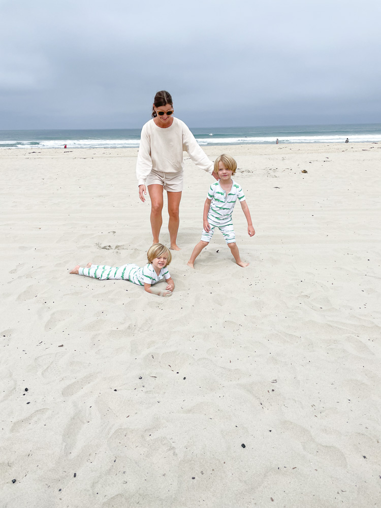 mom with two little boys at the beach