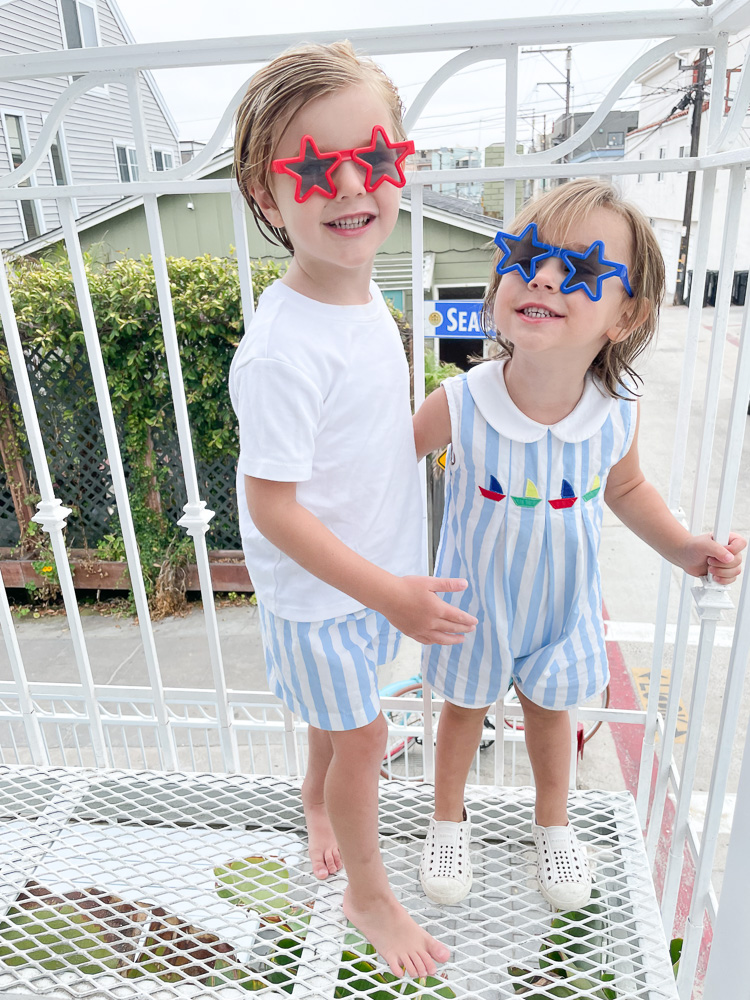 two little boys in star shaped sunglasses