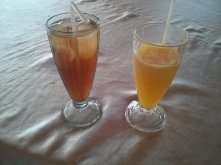 Fresh orange juice with ice and es teh (Indonesian ice tea).