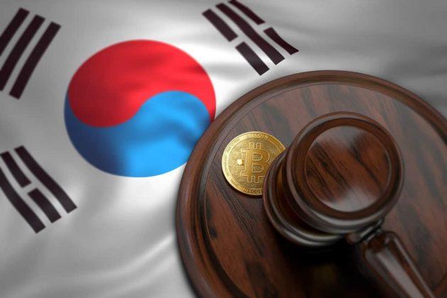 Bitcoin and judge gavel laying on Korean flag