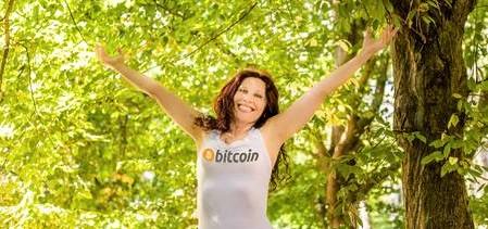 Happy woman wearing bitcoin