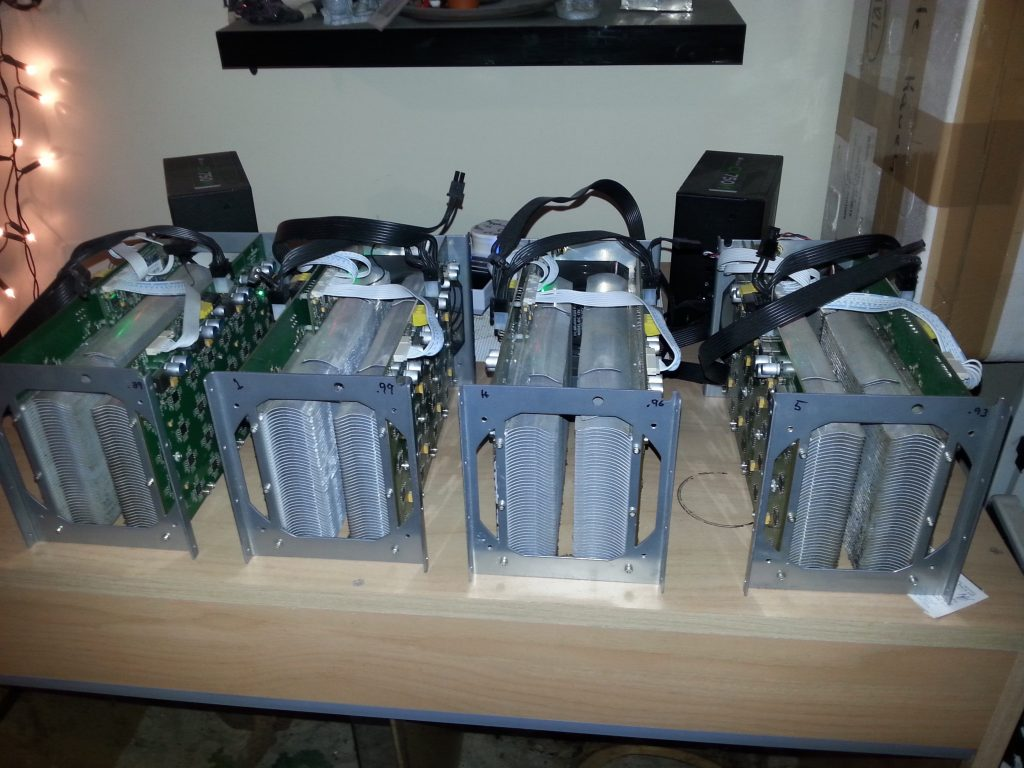 Our four antminer S1's mining away. Doubles as space heater, and also nightime heat mat for our pair of bearded dragons