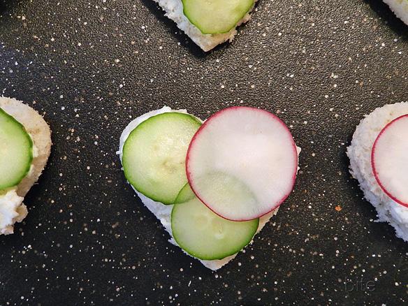 a dainty radish, cucumber and boursin tea sandwich