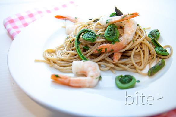 Spaghetti with fiddleheads and shrimp