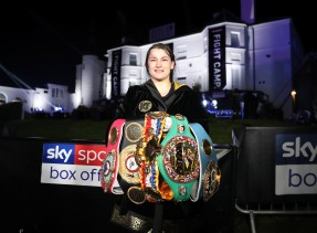 HANDOUT PICTURE COMPLIMENTS OF MATCHROOM BOXING Katie Taylor vs Delfine Persoon, undisputed Lightweight Title Contest. 22 August 2020 Picture By Mark Robinson Katie Taylor after the fight with her belts.