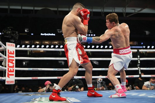 February 27, 2021; Miami, Florida; Saul Alvarez and Avni Yildirim during their WBA, WBC and Ring Magazine super middleweight championship bout at the Hard Rock Stadium in Miami, FL. Mandatory Credit: Melina Pizano/Matchroom.
