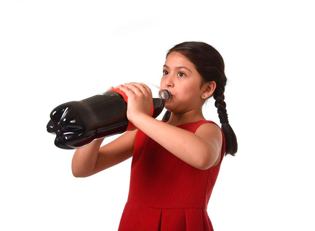 Child drinking big bottle of cola