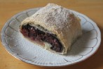 A puff pastry strudel filled with sour cherries and poppy seeds.