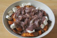 Sweet potato fries topped with onion gravy and feta cheese.