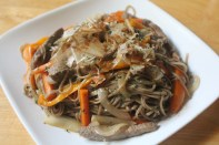 Soba noodles stir-fried with beef strips, bell peppers, carrots, and onions.