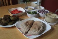 Falafel sandwiches with a selection of toppings of your choice.