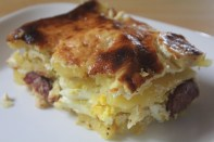 Potato casserole with hard-boiled eggs, Hungarian sausage, and plenty of sour cream!