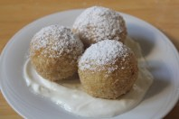 Cottage cheese dumplings served with sour cream and powdered sugar.