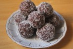 Chocolate cherry-filled rum balls rolled in shredded coconut.