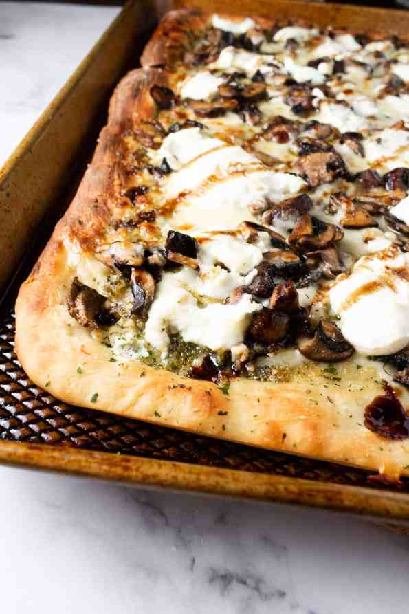 white pizza with mushrooms on tray